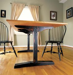 The one shown here is a standard two-pedestal table with a single stretcher tying the bases together.