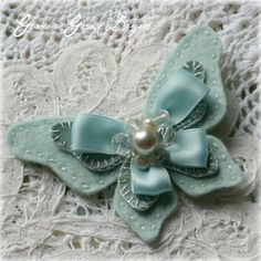 "I love this idea to add to the wedding dress or as part of the veil...for ""something blue"" and I LOVE  butterflies...so this is perfect! :) ribbon & felt butterfly"