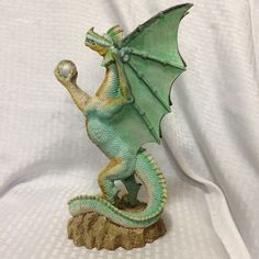 """Here is a Green Winged Dragon on Rocks Statue Holding Ball 12"""" Tall Resin Medieval Fantasy. Good for sci fi medieval displays, or even to put in an aquarium (with a good scrubbing). Appears to be made of resin, with no maker marks. 