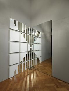 Daniel Buren: A white triangle for a mirror  Mirror, paint, fibreboard, white vinyl plastic