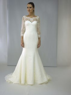 wedding dress fitted with lace, in my opinion look far more tatesful. Modest lace sleeves add quiet elegance.