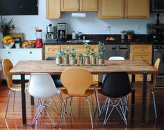 I like the dining table and mismatched chairs.  The twine-wrapped plants jars are nice too.