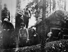 Jewish Partisans outside a hut they built in the Rudniki forest.