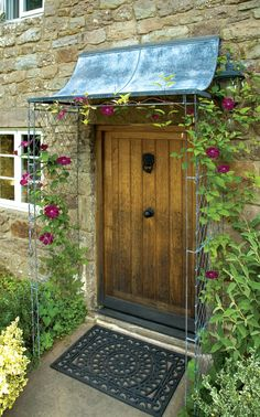 Bespoke front porch with scoop door canopy and side panels. Perfect for climbing plants to create a warm and classic feel to your home. http://www.garden-requisites.co.uk/ Hand made by Garden Requisites #doorcanopy #porch