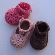 An adorable and fun pattern! Crochet these baby shoes for your special baby girl. Features pretty flower motif at toe and high-fitting, side-buttoning ankl