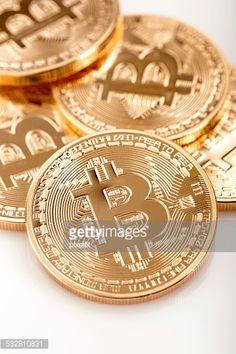 Stock Photo : Few golden bitcoins on white background.