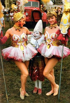 Vibrant, glistening costumes adore these 1950s circus performers