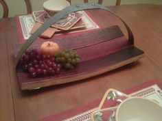 This Serving Tray / Basket is made from stave's out of a oak wine barrel the color is the natural stain from the inside of the barrel.  The handle is crafted from the steel band that secure the wine barrel