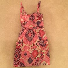Size 2 American Eagle Pink Aztec Print Dress Pink Aztec American Eagle Dress for sale. Side zip. Cute geometric cut out back. Pockets on front. Fits 3 inches above my knees (I'm 5'6). Slightly padded sweetheart neckline so you can wear it with or without a bra. Worn 3 times. No stains, damage, or rips. Perfect for a warm day. Tag says it's a size 4 but I think it fits more of a size 2-4. Please feel free to ask any questions or leave comments. Price is negotiable. Clean, smoke free home 😀…