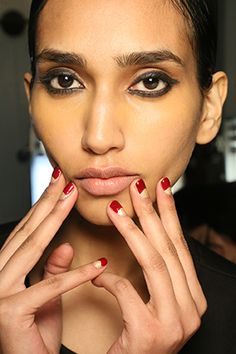 The look: The new half-moon.  The kit: ForSachin & Babi's half-moon nail look, manicuristNaomi Gonzalezapplied two thin coats of Zoya nail polish in Brooklyn followed bytwo coats of Courtney on the top quarterof the nail.