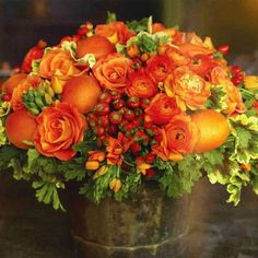 So pretty: roses, ranunculus, orange chincherinchee, hypernicum berries, and nectarines.  http://toastandtables.blogspot.com/2008_04_01_archive.html