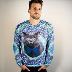 Looking like some kind of hypnotic, tie-died, bow tie wearing god, the Psychedelic Cat stares out of this powerful polyester sweater. We mor...