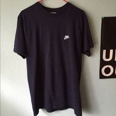 Nike tee This is actually a navy shirt & not black! This is t shirt with a small white Nike logo embroidered on the chest. Would look cute cropped! Open to offers Nike Tops Tees - Short Sleeve