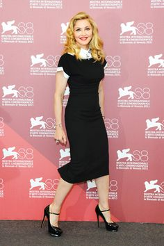 Madonna at the 2011 Venice International Film Festival. She looks stunning...except for the excessive problem to that one eye caused by excessive botox. C'mon Madge...you don't need that crap.