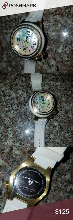 EUC - Swiss Legend Neptune Watch w/ Diamond Bezel White Swiss Legend Neptune watch with gold case and authentic diamond bezel. Mother of pearl face and rubber band. Great condition. Needs a new battery. Swiss Legend Accessories Watches