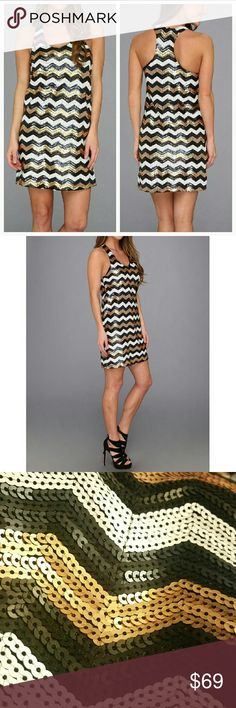 """'ROXANNE' SEQUIN chevron Print dress Happy New Years dress! Shine the brightest and make a statement in this Chevron print sequin party dress!! Sassy T- backline and scoop neckline. Pair with a sassy pair of heels and statement earrings!  Material 100% polyester/ lining 100% polyester  Length approx 34""""/Bust approx17"""" across Worn once  Size medium Dresses Mini"""
