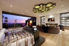 tv lift at foot of bed (lower sides make it look less obtrusive) Beverly Hills media room - modern - bedroom - los angeles - DSI Entertainment Systems Bedroom With Sitting Area, Tv In Bedroom, Master Bedroom Design, Dream Bedroom, Bedroom Ideas, Master Bedrooms, Bedroom Designs, Master Suite, Funky Bedroom