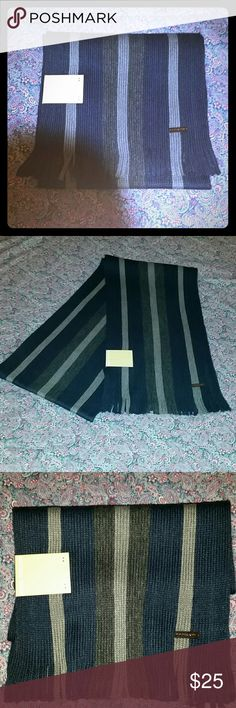 "NWT Michael Kors striped, fringed ends scarf NWT Michael Kors ""Striped Raschel Muffler"". Stay warm in style this winter!!! 100% acrylic. Blue and grey stripes with Michael Kors hardware on front of scarf. No reasonable offer refused. Bundle and save. Free gift with every purchase! Happy poshing! Michael Kors Accessories Scarves"
