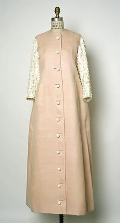 little augury, Balenciaga.a pink Balenciaga deshabille with white sleeves and white jeweled buttons, gift of Jayne Wrightsman.