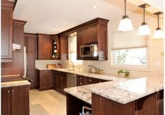 Kitchen Counter tops with dark wood cabinets