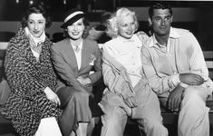 Fannie Brice (1891-1951), Lili Damita (1904-1994), Toby Wing (1915-2001) and Cary Grant (1904-1986) at a party hosted by Carole Lombard at Venice Pier, June 1935