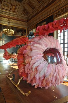 ❦ Joana Vasconcelos - Lilicoptère at the Chateau de Versailles, 2012 Photo: Kisa Lala The Château de Versailles was aflame with the fanfare Marie Antoinette would have expected had she arrived there in a chopper festooned with pink ostrich feathers, throwing cake-crumbs out the window. That's the way artist Joana Vasconcelos envisioned her entrance in her homage to the rock-star princess at the Sun King's former residence.