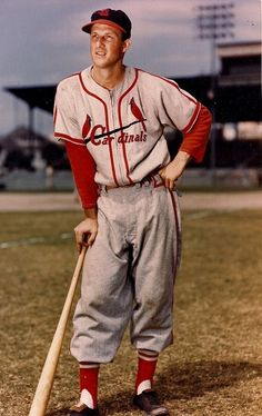 Full-length portrait of American baseball player Stan Musial, first baseman, outfielder and slugger for the St. Louis Cardinals, wearing his uniform and leaning on a bat while on a field, Credit: Photo File St Louis Baseball, St Louis Cardinals Baseball, Stl Cardinals, Baseball Players, Baseball Cards, Baseball Uniforms, Mlb Uniforms, Mlb Players, Baseball Stuff
