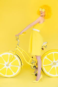DIY lemon photo booth ideas, like printable sunglasses and a sweet bike.