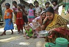Children watch as Rahima Begum, 45,  helps Taslima Akter, 28, right, make lifesaving oral rehydration salts, or ORS,  for diarrhea patients .~ ~~~~~~~~~~~~~~~~~~~~~ 'Poor man's Gatorade' could save kids from diarrhea death..