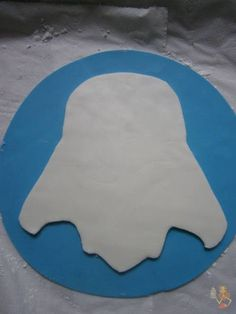 Here's a tutorial for Darth Vader cake. First, cut blue fondant circle (I've used my cake ring) to be the bottom, (I did that 'cause my cake was iced with whipping cream. You can do this, or you can put the image directly on the cake if it's...