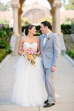 Flowers: Twigg Botanicals; Videography: 618 Studios; Officiant: Derek Rice; Calligraphy: Wendy Ware; Reception Music: The Heroes; Rentals: Found Vintage Rentals; Classic Party Rentals; Hair and Makeup: Swell Beauty; Transportation: Palomar Limousine; [getaway car] Lance Haynes (858-560-5737). See the Rest of the San Diego Art Museum Wedding Here