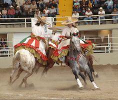 Escaramuza dresses flow while riding horseback side saddle.