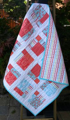 Check out this item in my Etsy shop https://www.etsy.com/ca/listing/226486501/modern-baby-quilt-coral-aqua-patchwork