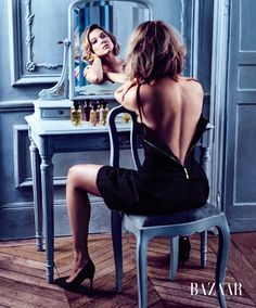 Léa Seydoux gazes into a mirror wearing black dress and heels for Harper's Bazaar US Magazine September 2016 issue