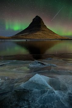 "Geminid meteor. Kirkjufell, Iceland 2012-12-15. (Photo: David Clapp)   This is a fantastic image and the photographer seems to have been so excited about the meteor shower, he didn't even mention the northern lights display. What riches! ©Mona Evans, ""Meteor or Meteorite & Other Posers"" http://www.bellaonline.com/articles/art29545.asp"