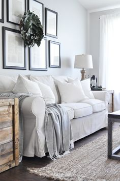 Beautiful slipcovered farmhouse style sofa and armchairs from Ikea!  ***Side table crates***