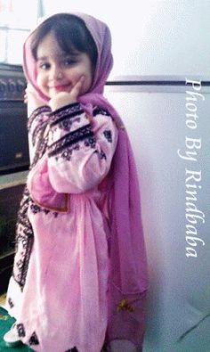 A cute Balochi Girl in her traditional Dress.