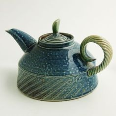 Green and blue teapot. Wheel thrown with moulded spout and modelled lid decoration and handle.  Jane Hamlyn