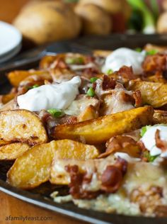Loaded Pub Fries - Baked potato wedges smothered in cheese, bacon and sour cream and seasoned with smoked paprika.
