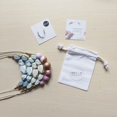 my wooden necklaces come to you with an instruction card and a white cotton bag #geometricnecklace #woodnecklace #handpainted #necklace