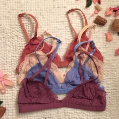 FRANCESCA delicate lace bralette - 8 colors Beautiful triangle bralette, low-cut style with delicate lace all over. Double spaghetti straps in the front with soft, comfortable and smooth elastic band. Hook & eye closure at the back. No padding, and lined on the inside, and Semi Sheer.  Size S/M fits A/B cup Size M/L fits B/C cup  (95% Nylon, 5% Spandex)  8 colors available: WHITE, BLACK, LIGHT PEACH, SILVER GREY, RUST, SOFT VIOLET, GARNET, WILD BLUE  NO TRADE, PRICE FIRM Bellanblue…