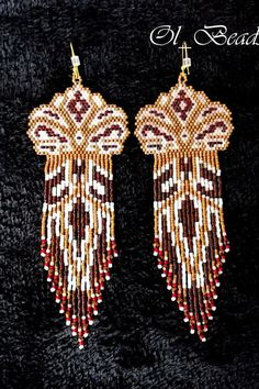 Luxurious beaded long fringe earrings of my original design, in rich golden, garnet, red, bronze and white tones. Native American Style inspired.  High quality Japanese Delica and round seed beads, Czech glass beads, gold plated ear wires.  Length - 13cm (including ear wires). Width - 4.5сm top part; 3cm fringe.  All items starting from $40CAD and over are sent (Canada Post) with insurance and tracking number. If you are not willing to spend your money on tracked delivery, please contact me…