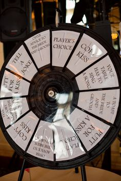 """Kissing Game - DIY wheel - TOTALLY doing this instead of """"clicking of glasses"""". I would change the wording of the pie pieces wedding games A Black, White and Red Wedding in Winnipeg, Manitoba Diy Wedding Games, Wedding Mc, Wedding Games For Guests, Unique Wedding Favors, Wedding Kissing Games, Rustic Wedding, Wedding Shop, Wedding Ideas, Reception Activities"""