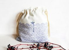 LINEN POUCH HANDPRINTED JAPANSES WAVES HAND EMBROIDERED DRAWSTRING BAG  Delicate hand embroidery pouch with a beautiful handprinted japanses waves and hand embroidery. It is a beautiful pouch made from white thick linen with a rustic look. You can use it as a make up bag, holiday travel bag, home decor bag, you can also use this bag to store vegetables, drie nuts. Store Vegetables, Japanese Waves, Embroidered Bag, Holiday Travel, Bag Storage, Travel Bag, Hand Stitching, Drawstring Backpack, Hand Embroidery