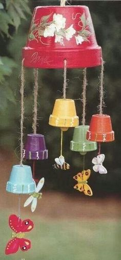 Clay flower pots made into a wind chime. Cute.