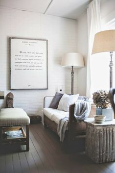 Simple use of a large, framed Saying to decorate the wall. The white background of the print looks great with the white painted brick wall. — The Decorista