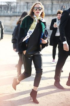 Street Style—Olivia Palermo in black leather pants, a black sweater, black stiletto ankle booties, sunglasses, sweater and skinny scarf