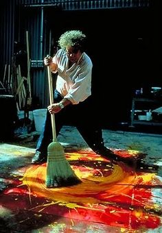 Dale Chihuly drawing with a broom