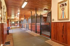 This equestrian paradise is a special and rare opportunity to own a property with over 10 acres this close and hacking distance to the horse show. The custom barn boasts 16 stalls that are all 14x14 with plenty of turnout. The owners quarters upstairs is right out of a magazine as is custom designed and decorated.Please see supplement remarks for more details on the custom home.