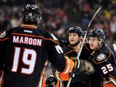 Kevin Bieksa of the Anaheim Ducks celebrates his goal with Mike Santorelli and Patrick Maroon of the Anaheim Ducks to take a lead over the Winnipeg Jets Ryan Kesler, Anaheim Ducks, Jets, Nhl, Motorcycle Jacket, Hockey, Kicks, Take That, Sports News